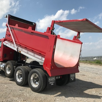 ROGERS trademark hydraulic hi-lift tailgate is an industry leader in design and performance.